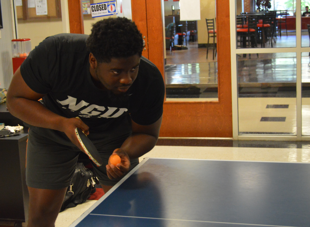 Dominique Richardson prepares his serve.