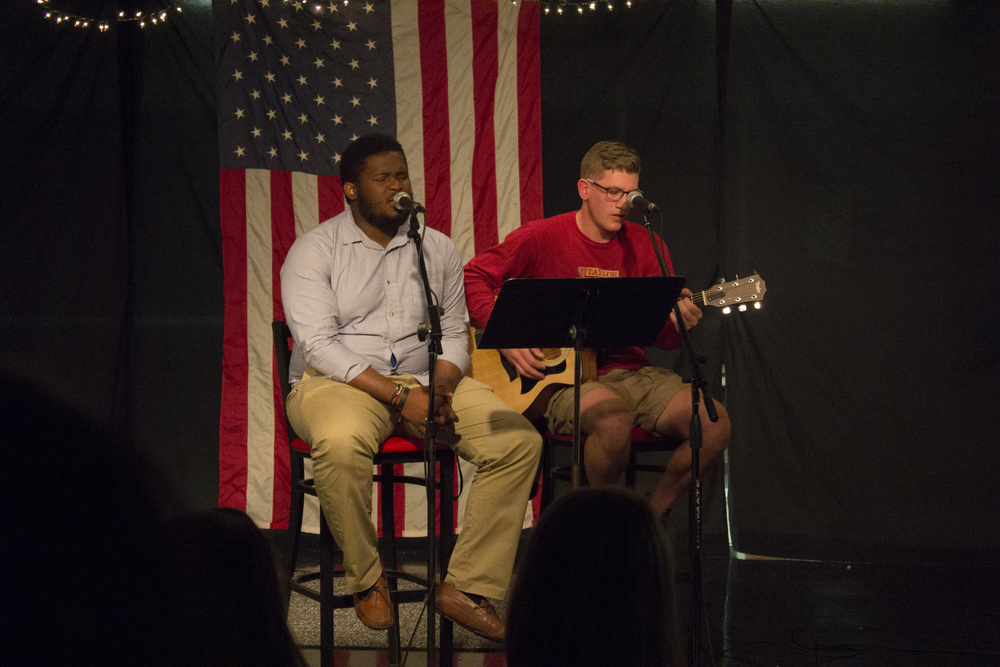 """James Tucker, on guitar, sings """"I Can't Make You Love Me"""" accompanied by Mykel Purdue."""