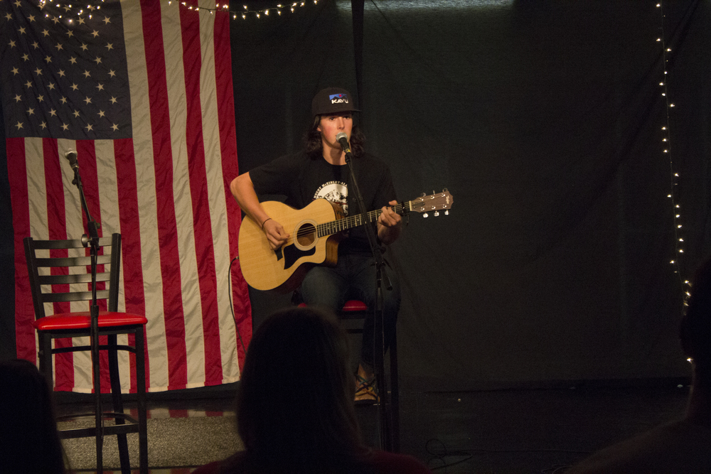 """Josh Sandifer sings a new song to him and several members of the audience called """"Cleopatra"""" by the Lumineers."""
