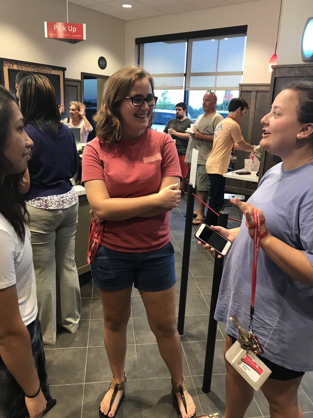 Paola Martz (freshman), Marissa Holst (freshman) and Abbey Roberson (freshman) eagerly wait in line to order at the brand newChick-fil-A.