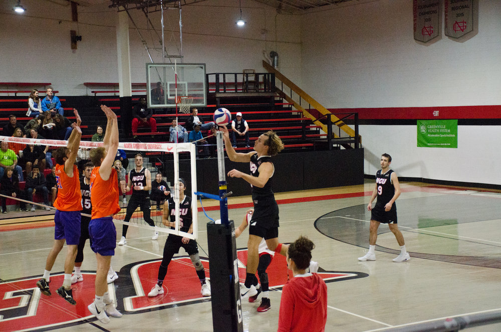 Kyle Brandt, junior, easily taps the ball over the net past the defenders.