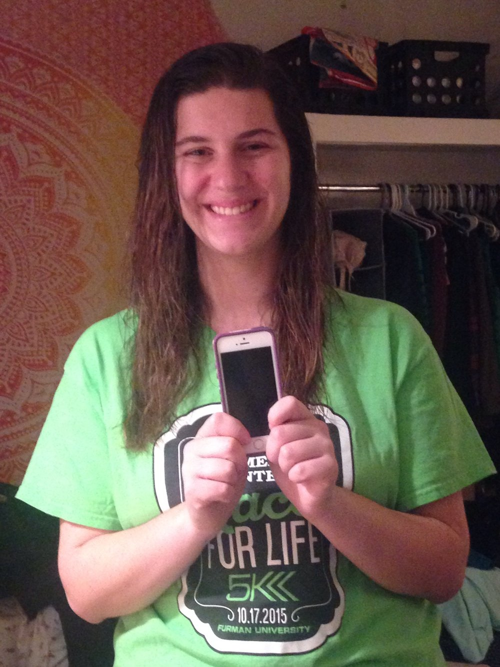 Sara Williams (Sophomore - Secondary English Language Arts Education) is posing with her favorite gift, her phone given by her dad.