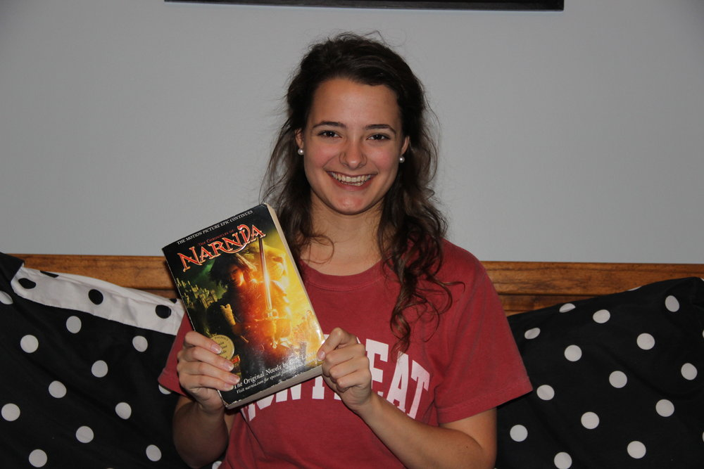 Nicole Daniel (Freshman - Digital Media) smiling with her favorite gift. The whole collection of the Chronicles of Narnia, all in one book. Plus, she had the chance of Douglas Gresham signing it.