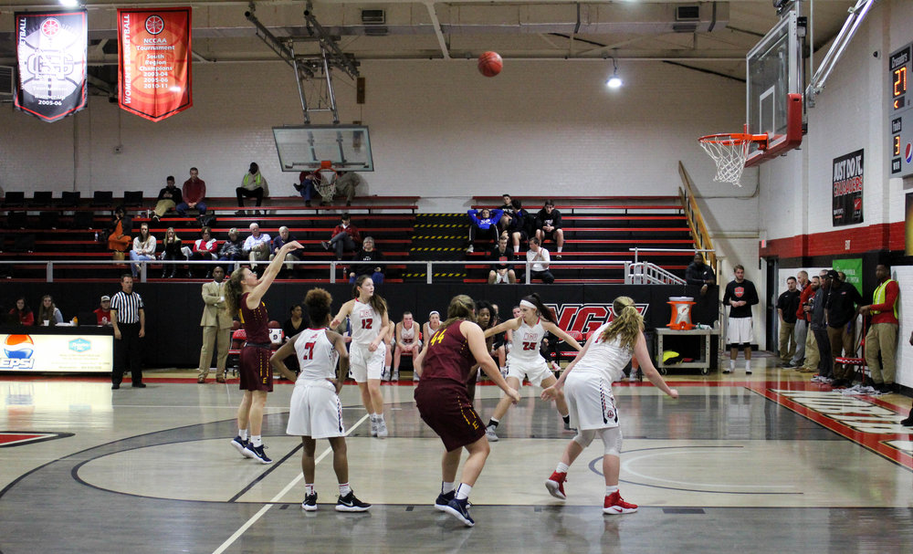 Savannah Hughes (21), Ayano Shelton (12), Elizabeth Trentham (25) and Karen Donehew (14) box out Emmanuel College's players and get ready to catch the rebound.