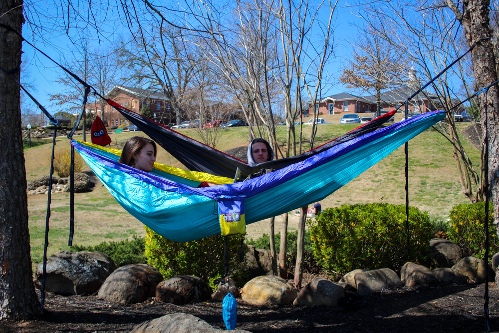Junior psychology major Meghan Miller and junior marketing major Jordon Connor take advantage of the nice weather and study together in their enos.