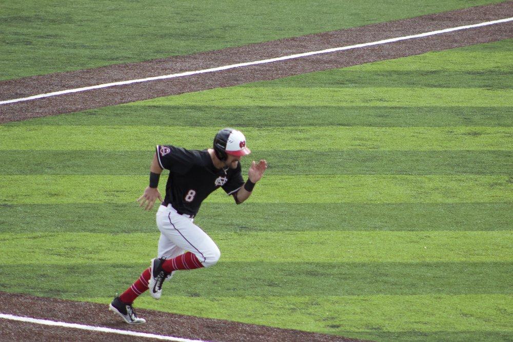Josh Black running for first base.