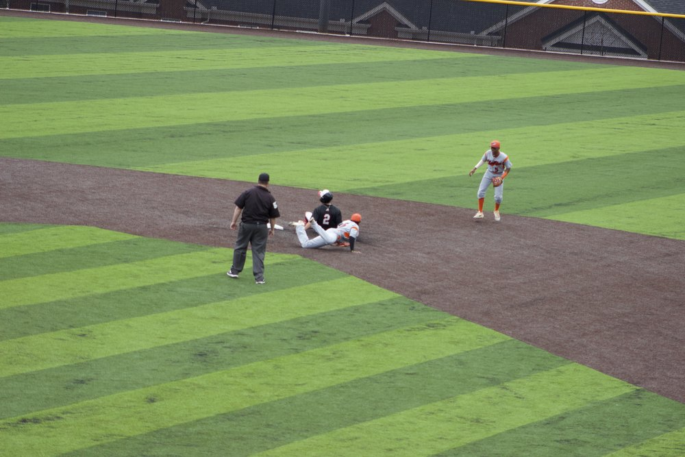 Utah Jones sliding into second base safe.