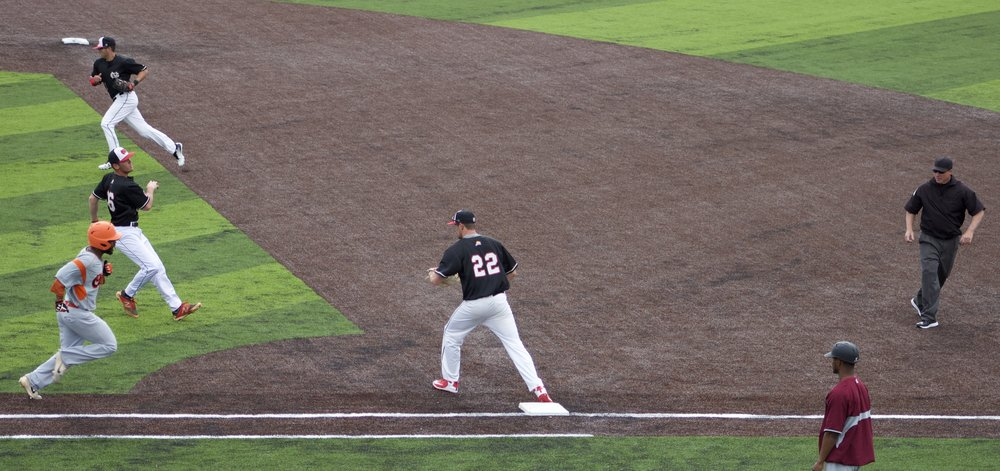 Trent Spikes and Andrew Plunkett shut down an attempt at first base.