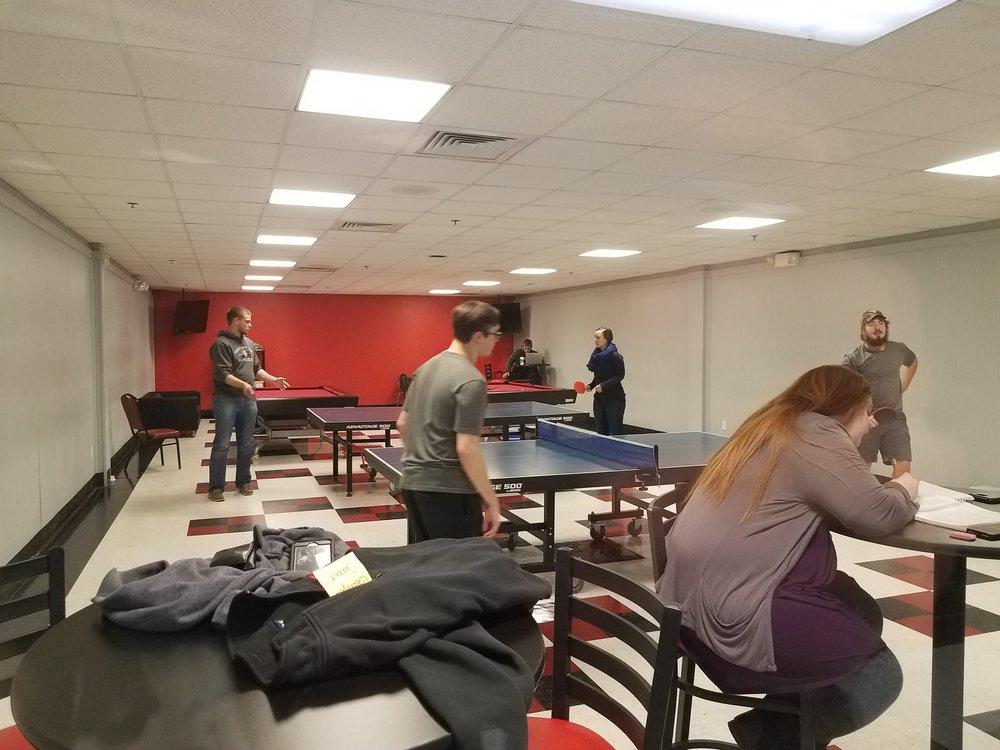 Landon Miller, Eric Guin, Karissa Sundt and Jason Howard play table tennis in the Game Room.