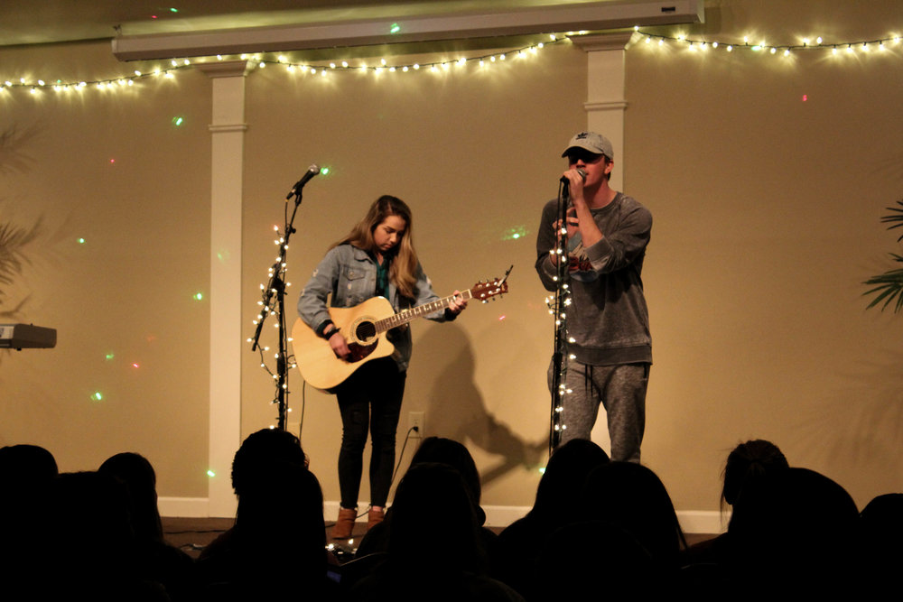 As Katelyn Carter plays the guitar, she and Nick Boggs sing together.