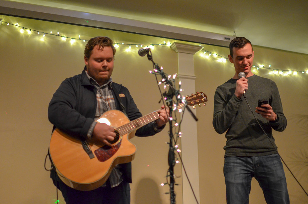 Jacob Thornton sings along with Blake Faulkner to Sailboat by Ben Rector as Faulkner plays the guitar.