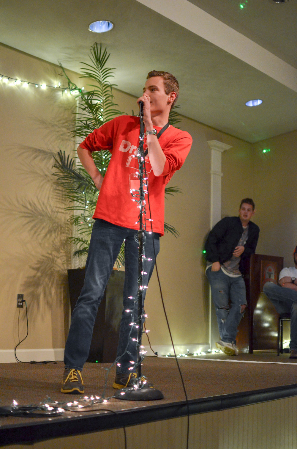 Landon Graber, an overnighter at NGU, performs standup comedy at coffeehouse.