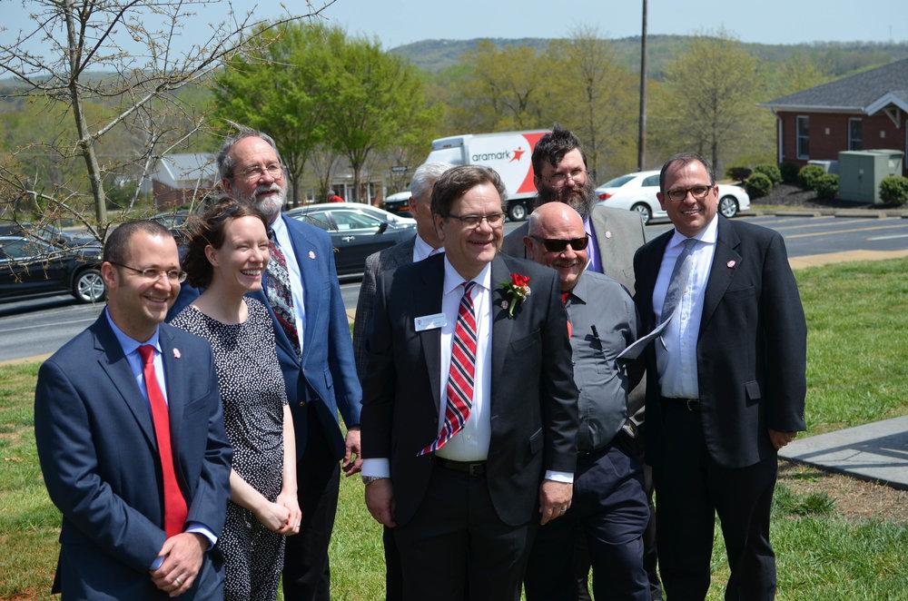 President Gene Fant posing with university professors.