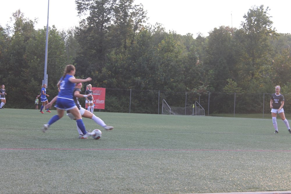 NGU's number six, Camryn Pagliaro attempting to cut off the landers attacker, Kylee Eppl to get the ball.