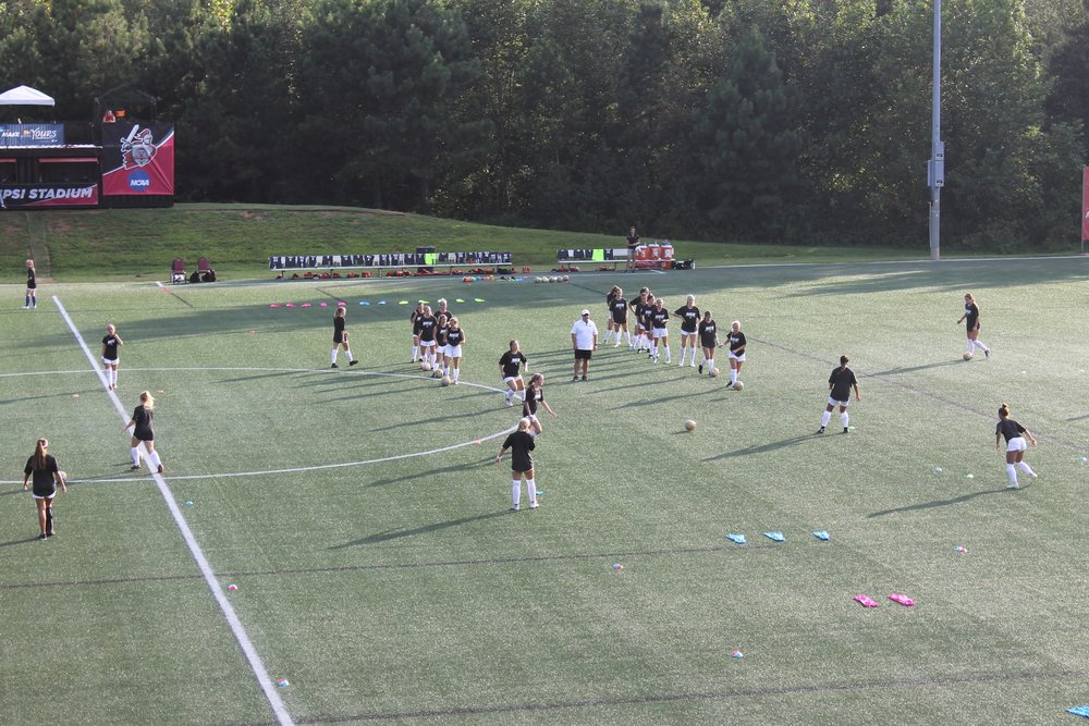NGU ladies soccer team warming up before the game; preparing to play against Lander University.