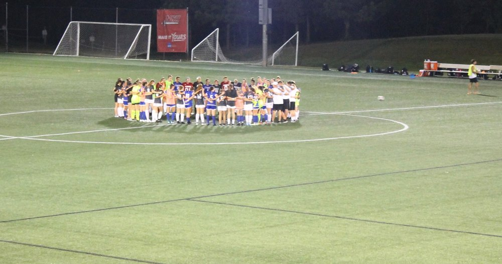 NGU and Lander University come together after the game to all pray together and shake hands.