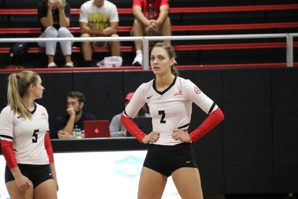 Freshman, Paige Beisecker (5) takes a mini break during the game.