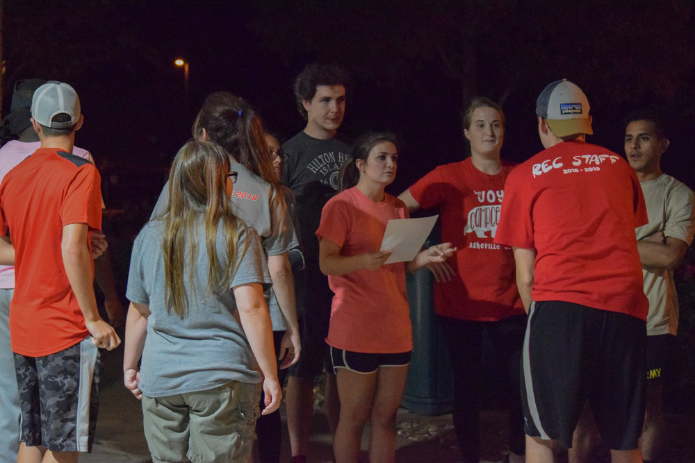 The animal science club listens to their official as he gives a run down of each event.