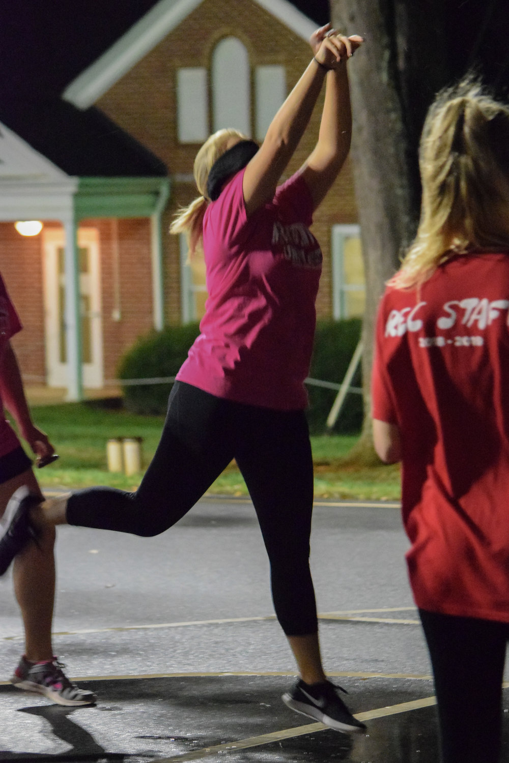 Big and Little club member Mary Collins, sophomore, makes the effort to make a basket in ten shots while blindfolded.
