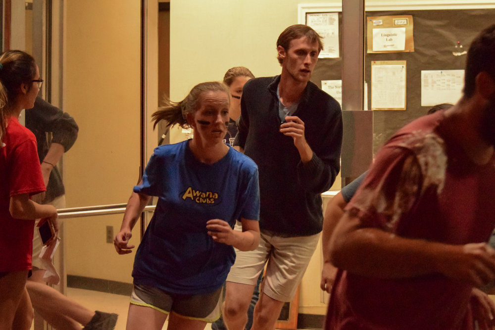 Education club members Cody Pendarvis, senior, and Constance Revis, junior, rush after their team as they finish the trivia section of the race.