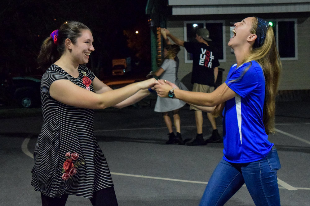 Freshman Sarah Campbell and sophomore Haley Suskin express their joy as they dance together, proving you don't have to have a date to dance.