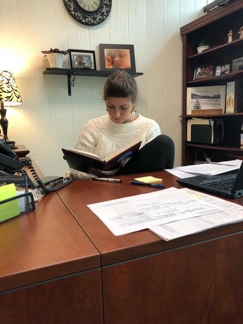 Lydia Rodgers reviews her schedule sitting at her desk.