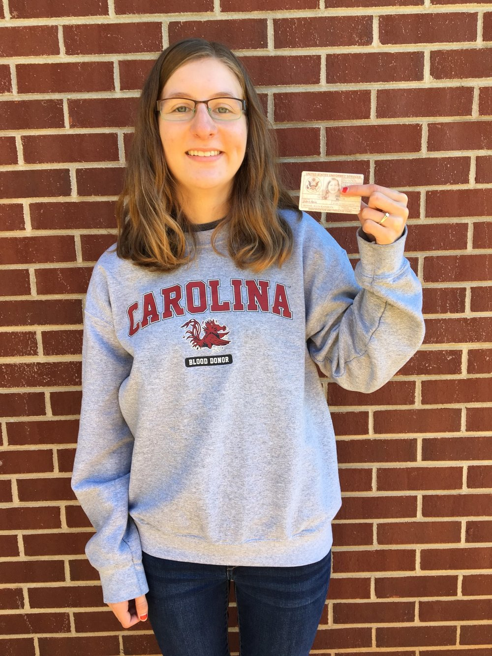 Julia Devine shows off her military I.D.