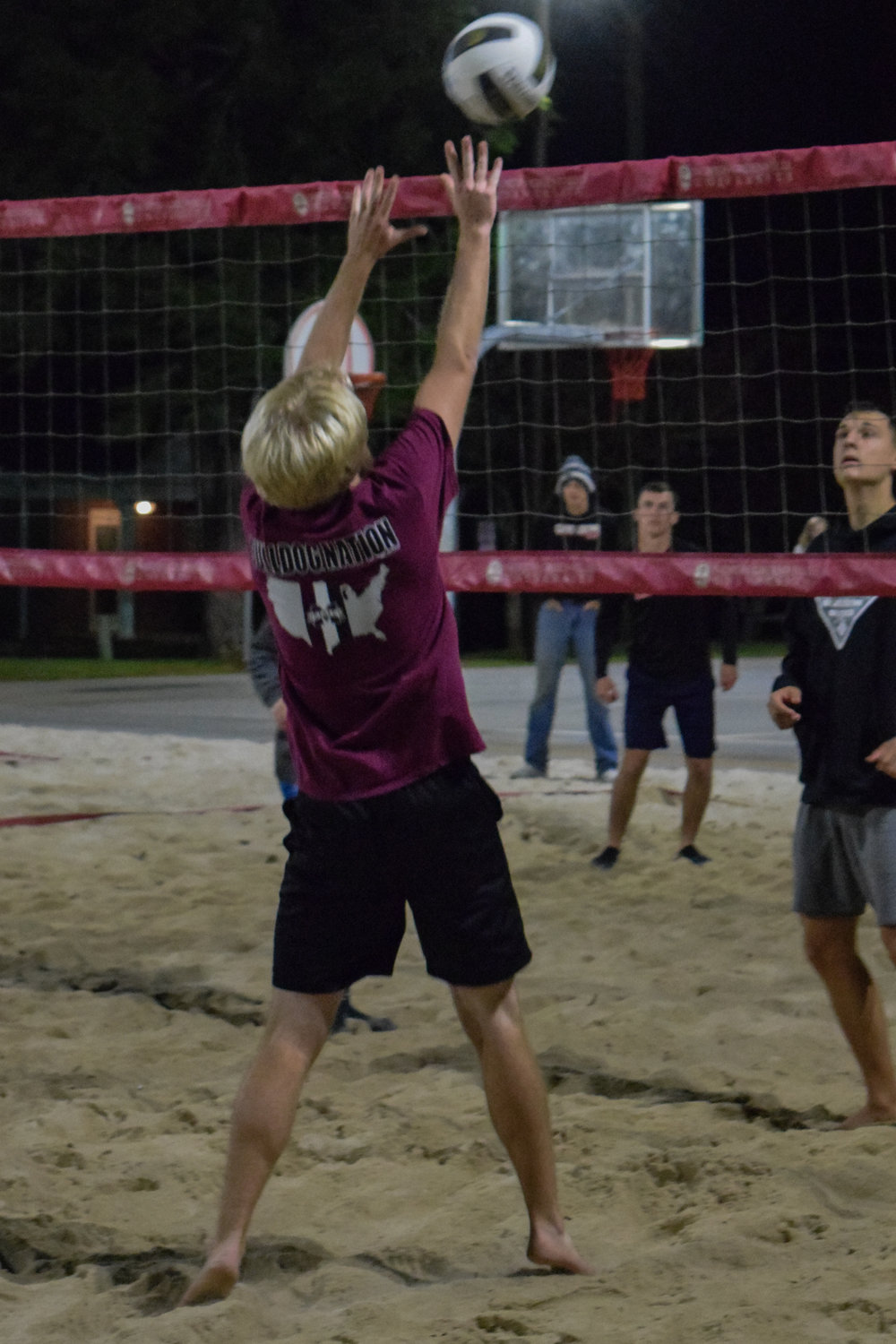 Clark hit the ball back over the net after the serve to begin the volley.