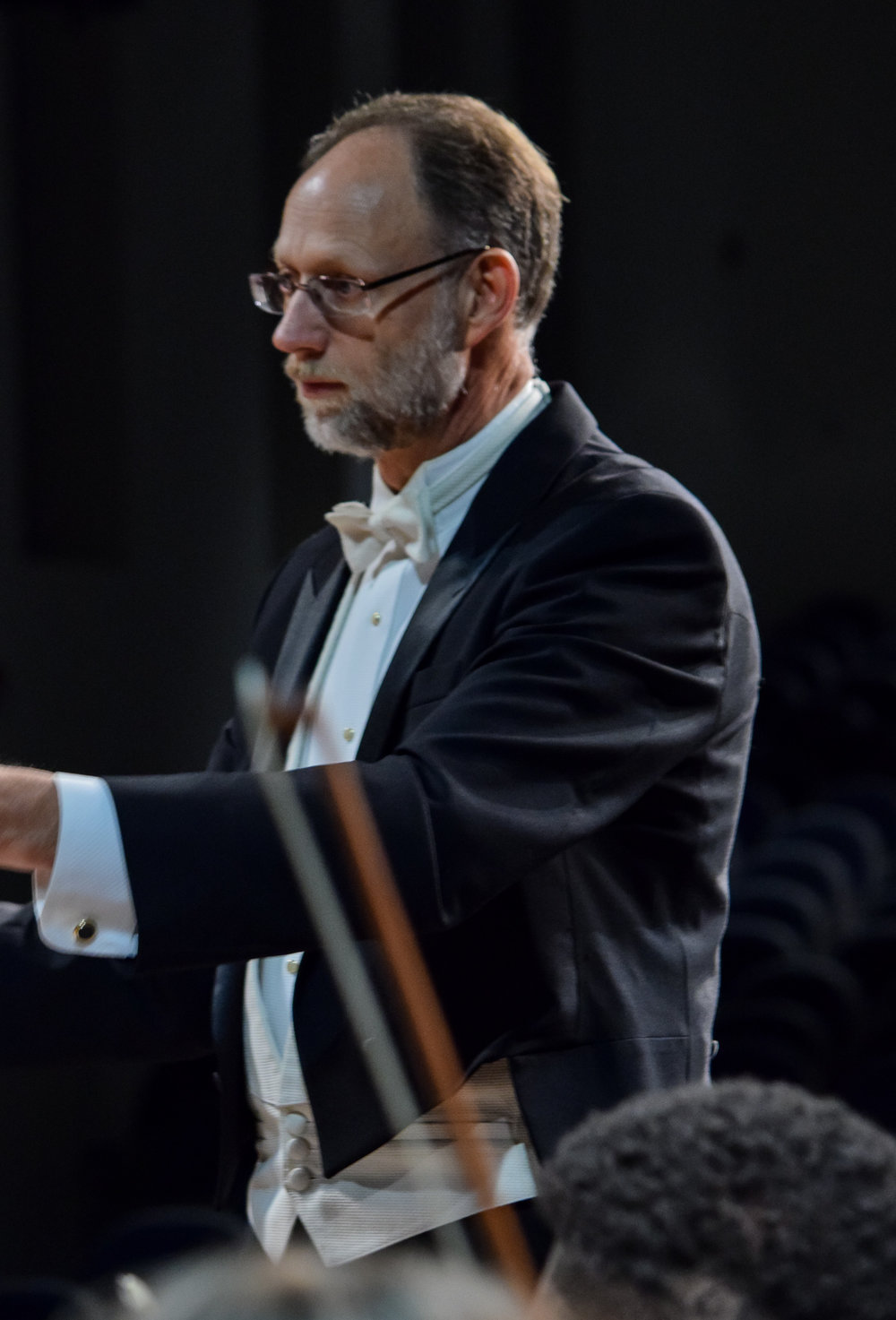 Conductor Michael Weaver shows his focus as he makes sure the orchestra stays in time.