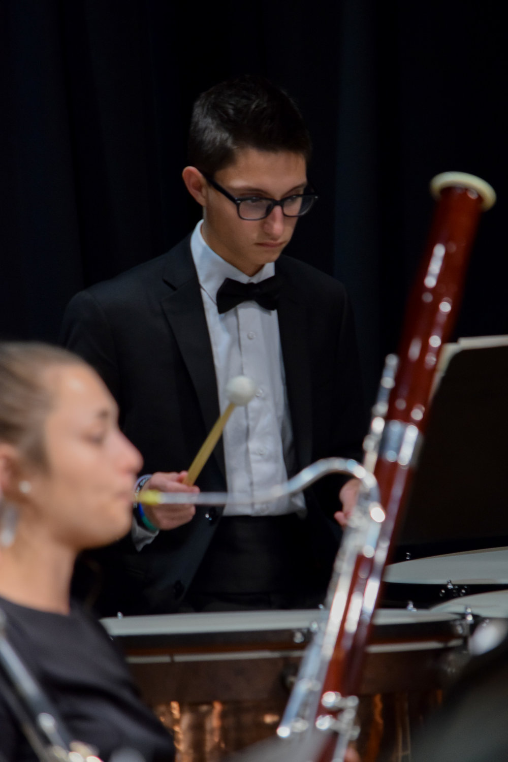 Junior, Devon Barnett studies his music carefully in order to come in at the right time.
