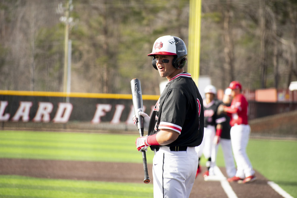 Senior Utah Jones (2) waits to swing the bat during a small pause in the game because of the ball needs to get back to the pitcher.