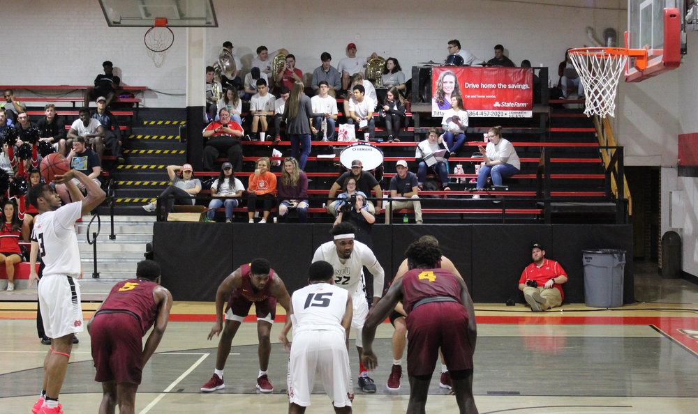 Tate, 3, shoots from the foul line alongside his teammates sophomore, 15, Ryan Mobley, and senior, 22, Roderick Howell anticipating to get the rebound.
