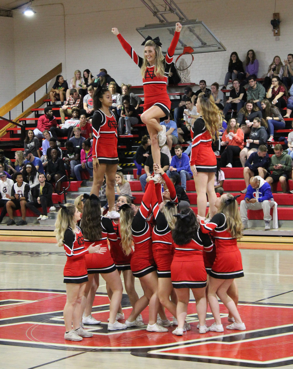 The North Greenville cheerleaders accomplish a stunt during one of the timeouts.