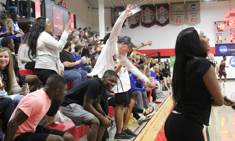 The North Greenville student section goes wild during the nail-biting game.