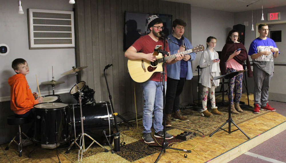 The White Flag Youth Ministry band practices before a Wednesday night of service.