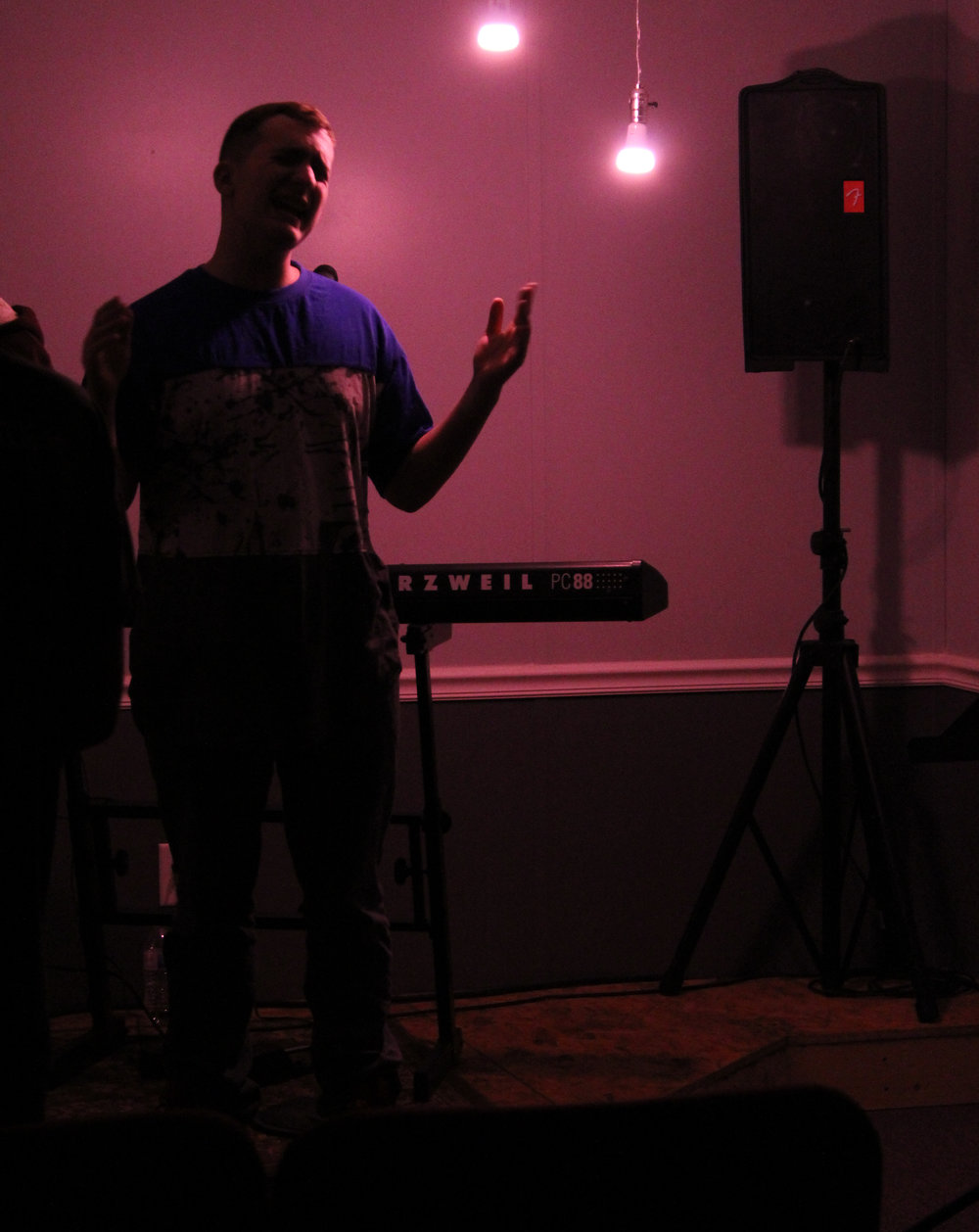 In the White Flag Youth Ministry, ranging from ages 12-18, students are encouraged to seek after God daily and are taught biblical and relatable material week after week. Pictured here is Noah Milholan singing on stage and worshipping God.
