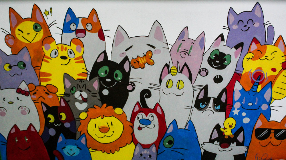Along the walls of the Organic Cat Cafe are hand painted cats.