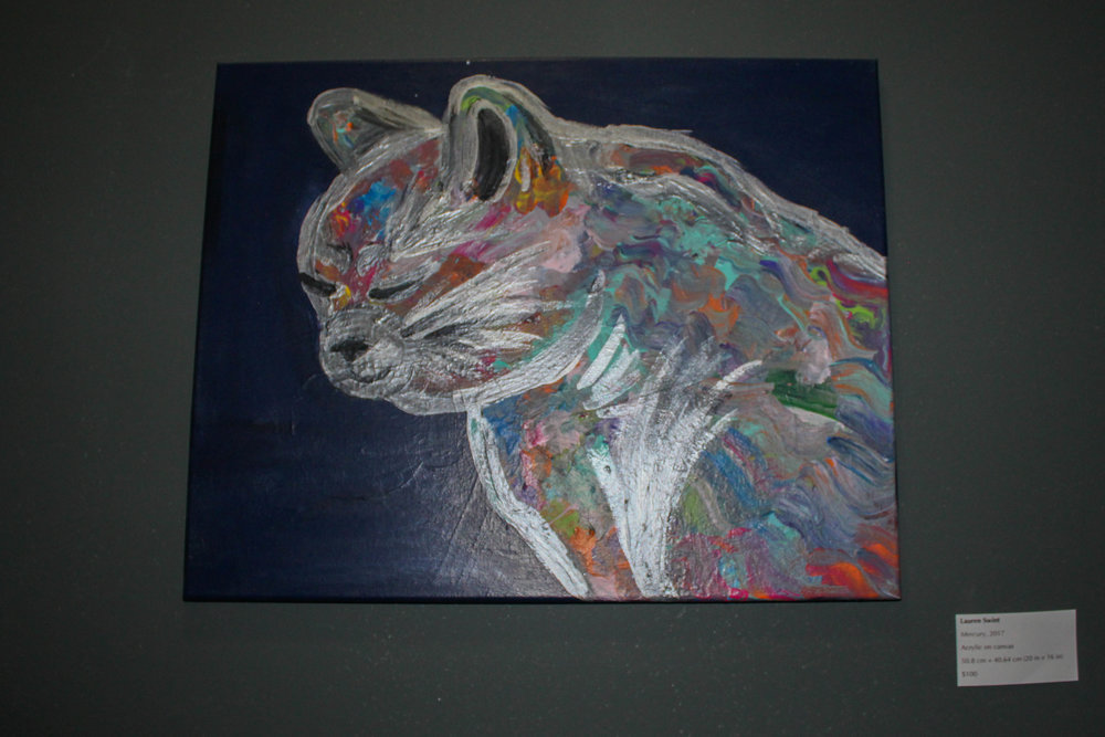 Featured throughout the cafe are portraits of cats made by local artists.