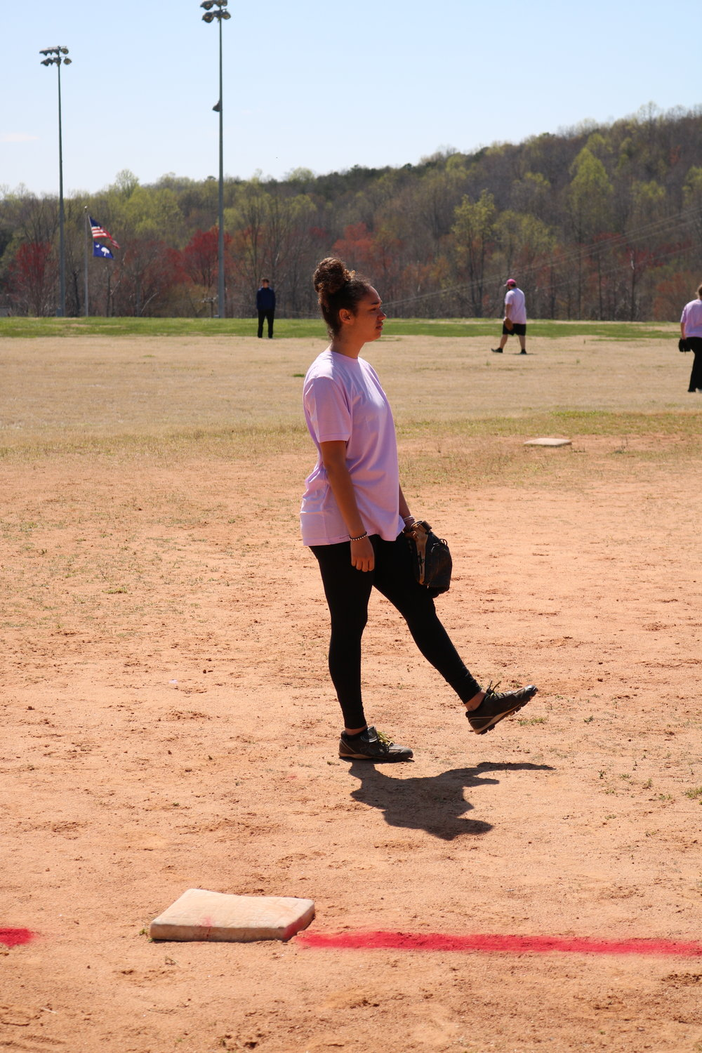 Freshman Lydia DuRant waits next to third base as the rest of her team gets into their positions on the field.