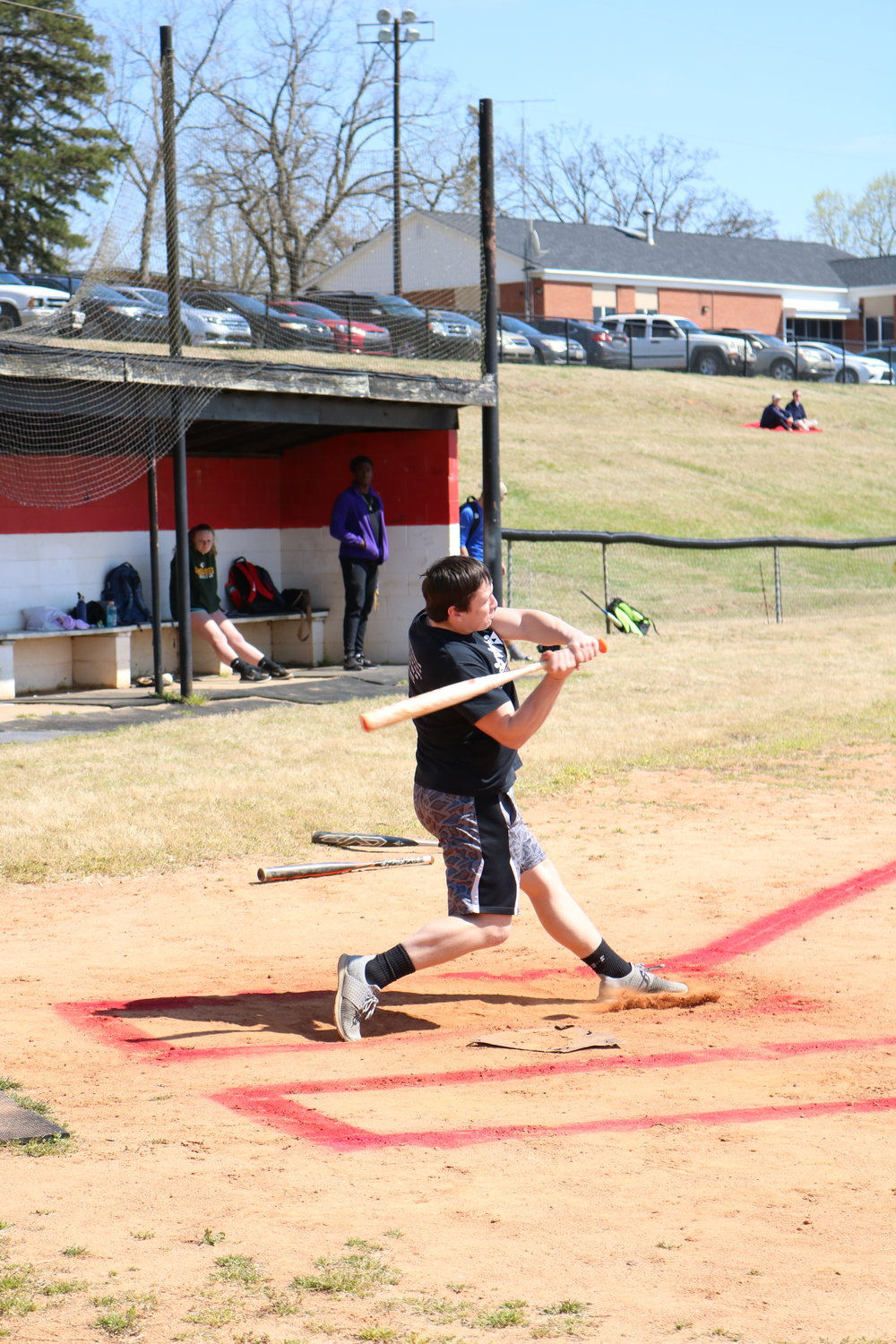 Freshman Jesse Haack takes a swing and ends up hitting a home run for their team BATsheba during the bottom of the 2nd inning.