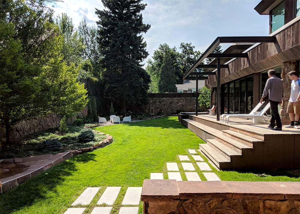 K. Dakin Design won the 2018 CARE award from the Custom Builder and Remodeler Council of Denver for the reimagination of the landscape around this classic organic-modernist home designed by Charles Haertling. The landscape design is inspired by the original home and it's materials, especially the distinct, clean lines of the architecture and the natural, stone veneer found on the house and landscape walls.