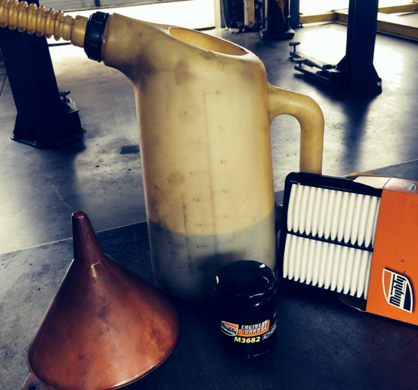 "Lube, Oil, Filter are essential maintenance! This ""old school"" photo illustrates that regularly scheduled maintenance never goes out of style.  Your vehicle's long life depends on it!"