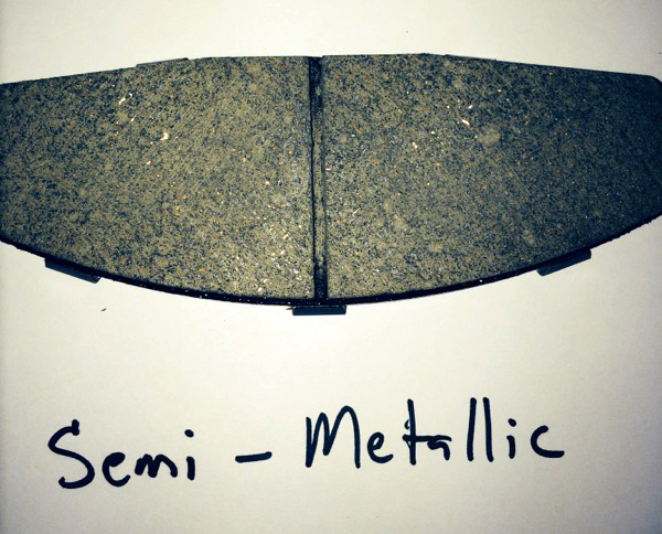 In a semi-metallic brake pad, something like steel wool is the main component (up to 60%) which dissipates the heat from braking action.