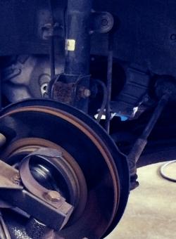 Brake lathe resurfacing rotor while on vehicle gives truer surface for longer brake life.