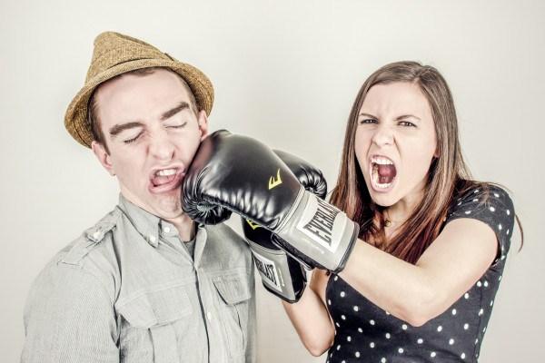 man and woman boxing