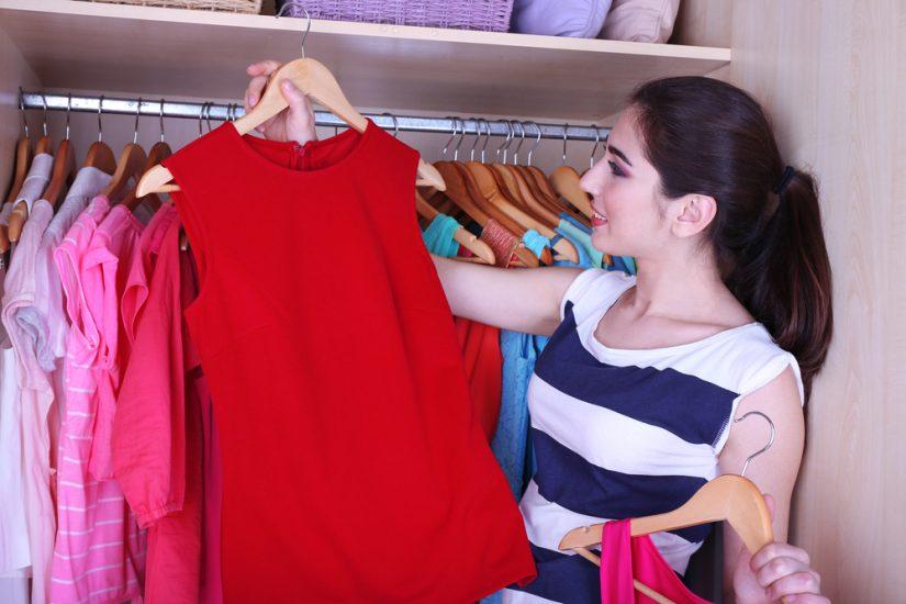 woman organising closet