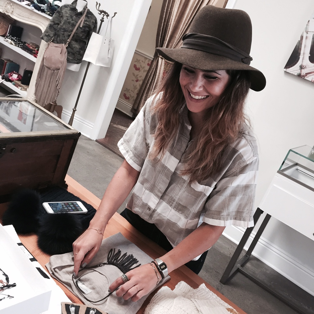 "Store Manager, Whitney, is all smiles about our newest ""Diamonds on the Fringe"" necklace."