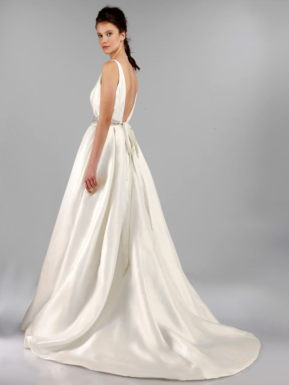 Tulle New York - Antonio Gual for Tulle New York believes that a wedding gown should be a true reflection of one's inner being. This stunning collection of gowns are known for their body-contouring feminine silhouettes and impeccable fit. Collection begins at $2,400.