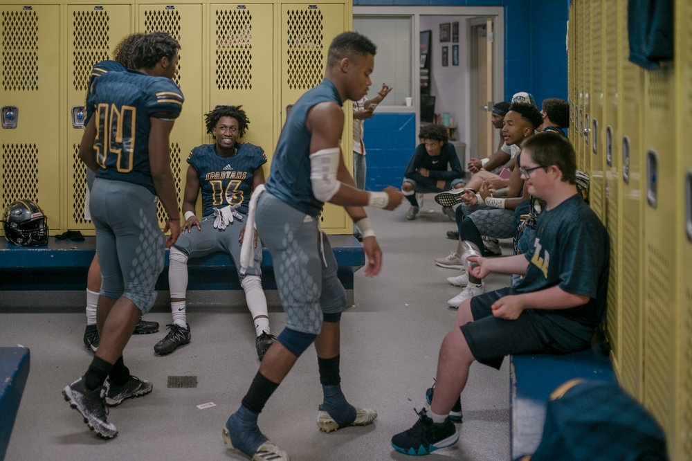 Muriel Battle High School football players wait in the locker room as officials discuss the new start time for a game against Smith Cotton High School on Friday, August 31, 2018 at Battle. Lightning delayed the game and caused all attendees to seek shelter.