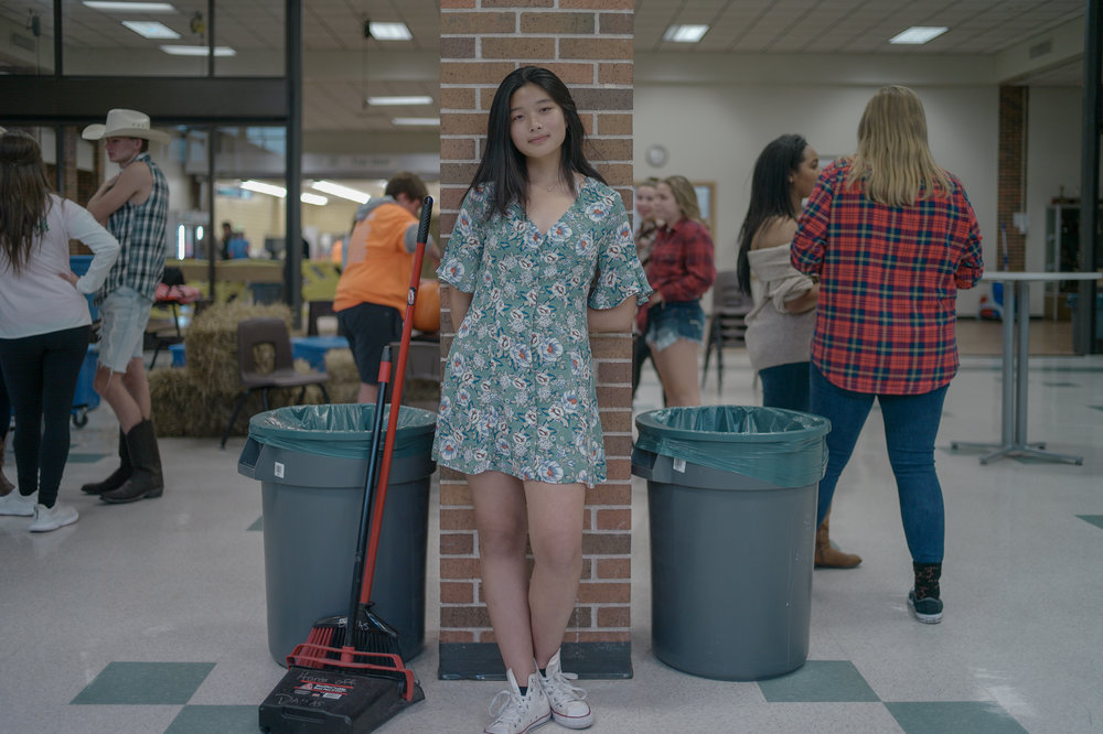 Moy Zhong poses for a portrait on Oct. 12 in the Rock Bridge High School cafeteria. As a student council member Zhong set up the homecoming dance at 2 p.m. that afternoon.